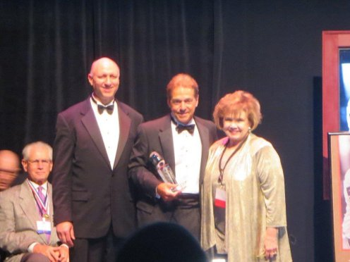 Dave Gyor, President of the BCSG and Dr Kay Collier McLaughlin with Blanton Collier Award winner Coach Nick Saban