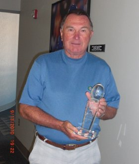 Rich Brooks with the Blanton Collier award trophy